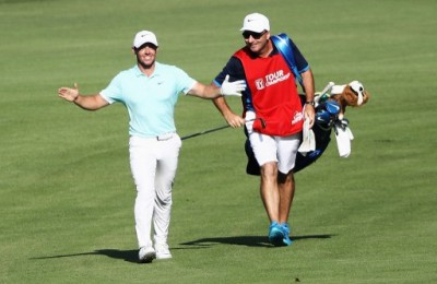 ATLANTA, GA - SEPTEMBER 25: Rory McIlroy of Northern Ireland celebrates alongside his caddie J.P. Fitzgerald after holing a shot for eagle on the 16th hole during the final round of the TOUR Championship at East Lake Golf Club on September 25, 2016 in Atlanta, Georgia.   Sam Greenwood/Getty Images/AFP